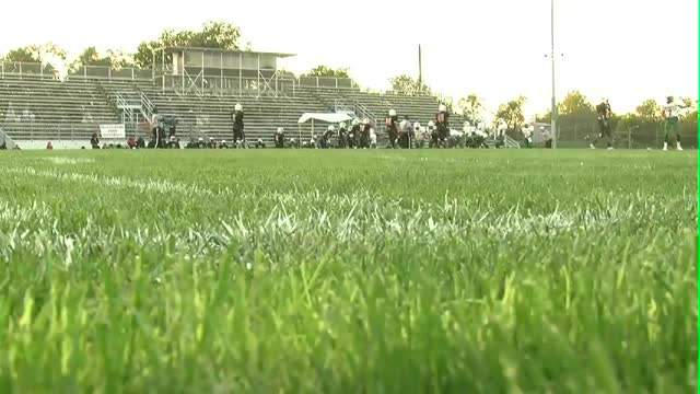 High school football players navigate dangerous field