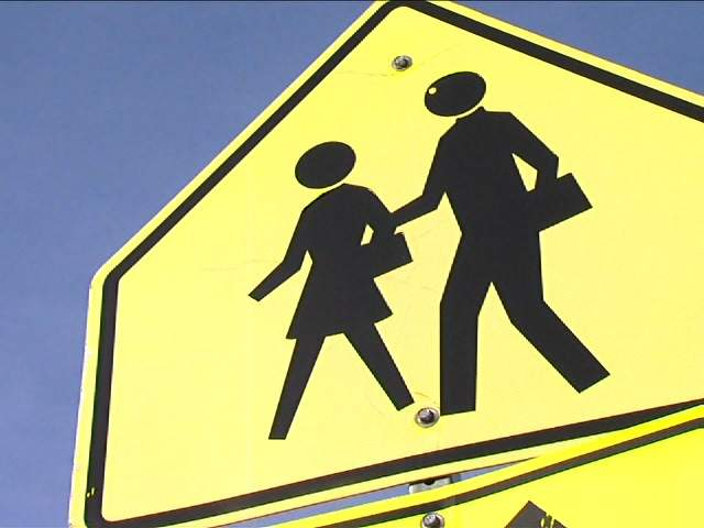 KSHB: SCHOOL CROSSING SIGN FILE