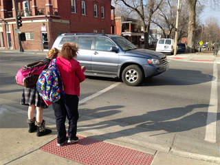 Students and parents near Holy Cross School protest the loss of nearby traffic light