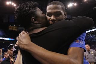 2 athletes make emotional gestures to mothers