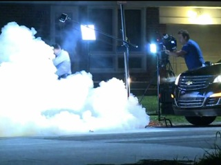 Tear gas used on protesters, TV crews