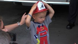 Toddler becomes honorary firefighter