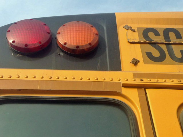 Bullet hits side of school bus, no injuries