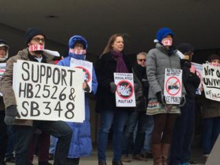 Staff, students protest guns at KU