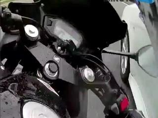VIDEO: Impatient motorcyclist runs into car