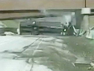 CAUGHT ON CAM: Semi-truck crashes onto its side