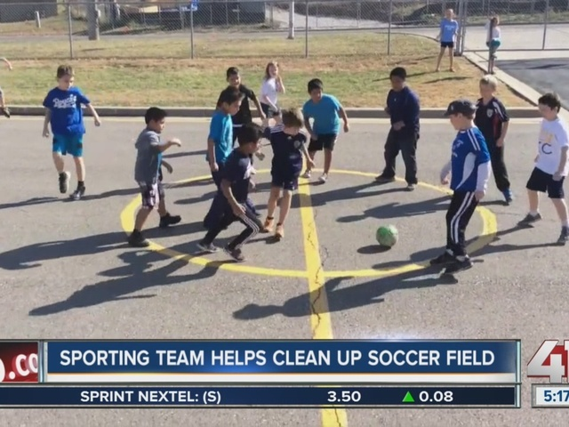 Sporting KC helps clean up childrens' soccer field