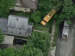 School bus runs into KCMO yard