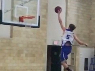 Basketball player dunks from free throw line