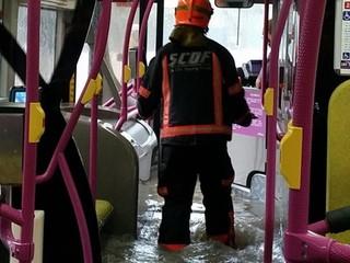Bus passengers stranded in flood waters