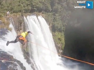 Climber makes headfirst dive down a waterfall