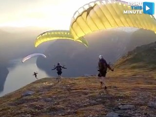 Parasail flight loops & soars through mountains