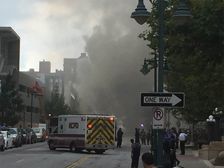 Smoke & flames seen coming from manhole downtown