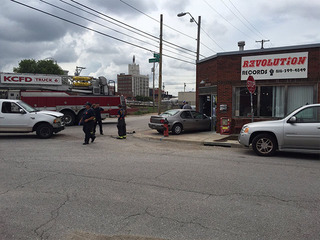 Car crashes into storefront in KCMO