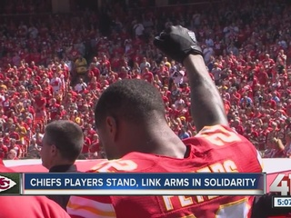 Marcus Peters raises fist during national anthem