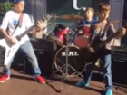 Kids shred Metallica on the Country Club Plaza