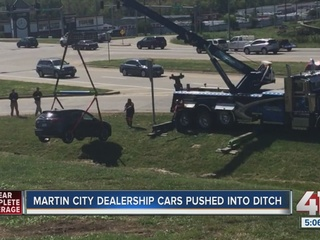 Cars at Martin City dealership pushed into ditch