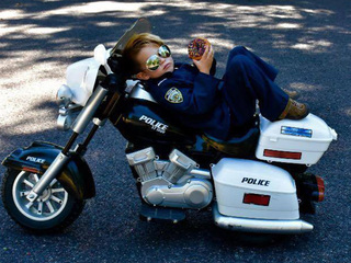 PHOTOS: 5-year-old 'officer' helps keep OP safe