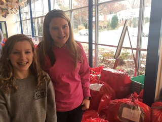 Dozens of red bags help families in need