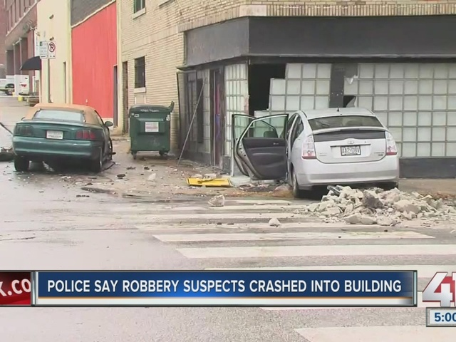 Car crashes into building in the Crossroads