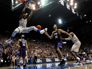 KU rolls TCU, earns 13th straight Big 12 title