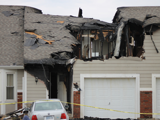 OP fire victims return to damaged homes