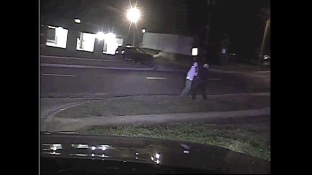 Dashcam video shows man and Overland Park officer struggle over gun
