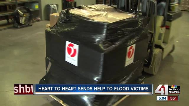 KC volunteers taking supplies to flood victims
