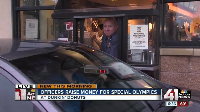 Cops top Dunkin' Donuts roof, collect sprinkles