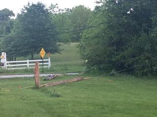 Dump truck knocks down power lines near I-470