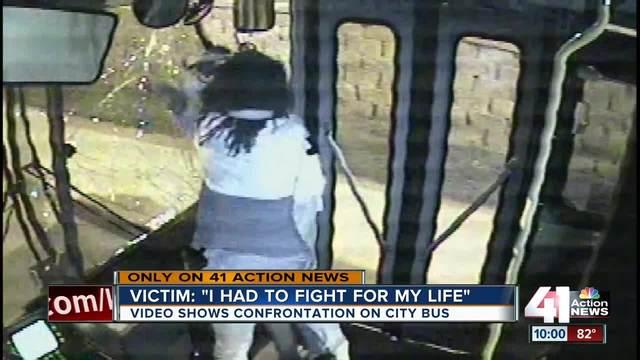 Men fighting on bus crash through windshield