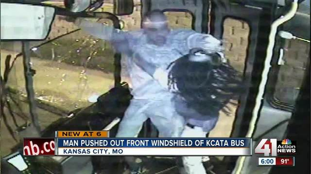 Man falls through bus window during assault