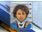 Woman charged after 8-year-old son found dead