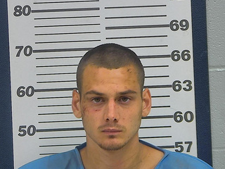 Man charged with escaping custody, stealing car