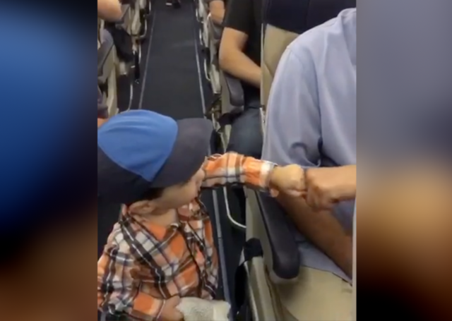 Adorable toddler fist bumps everyone on Southwest flight
