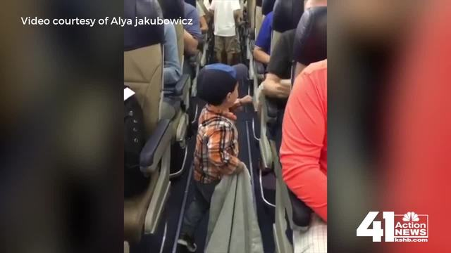 Toddler Fist-Bumps Passengers While Boarding Plane