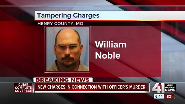 2nd man arrested in officer's death, faces tampering charge