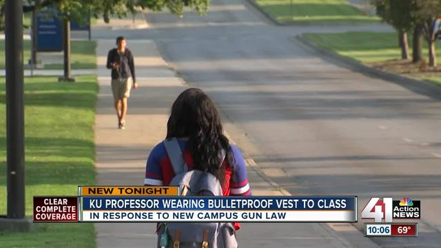 KU Professor protesting campus gun law by wearing flak jacket in class
