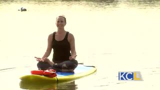 Michelle tries stand up paddle boarding yoga