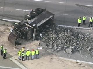 Overturned truck blocking traffic on I-35