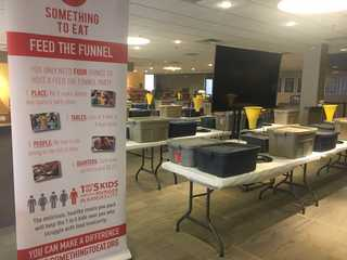 Church preps to pack 30,000 meals using funnels