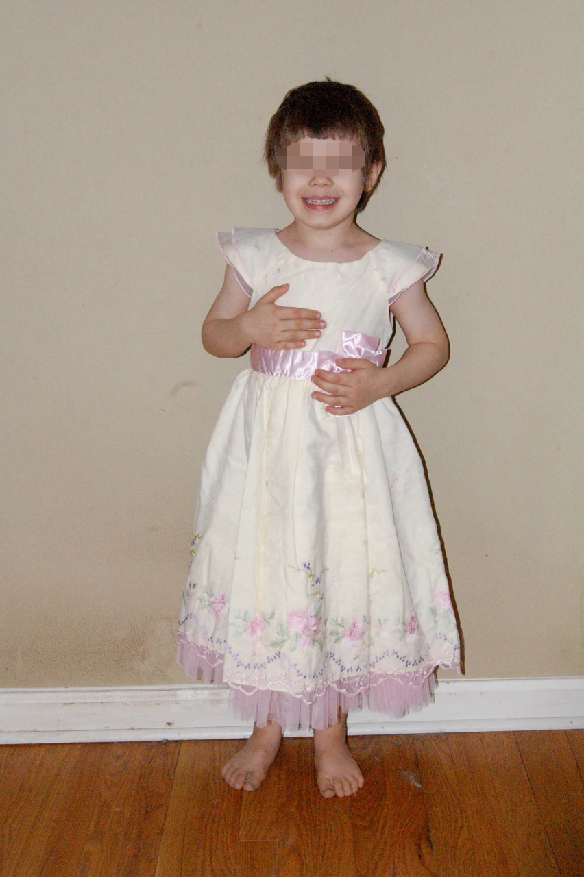 AJ in white dress