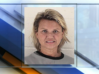 OP woman charged with theft of more than $100K