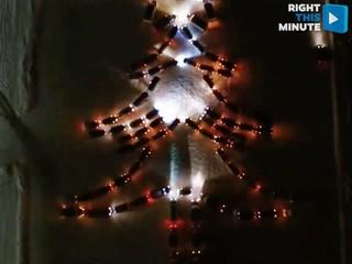 Drivers use their cars to create Christmas tree