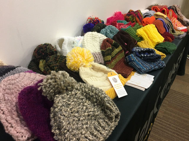 Knitting Scarves For The Homeless : Marksnelson employees knit for wrapped in warmth