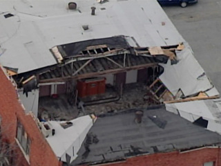 Officials examine partial roof collapse in KCMO