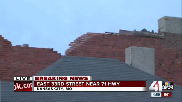 Officials Examine Partial Roof Collapse Along East 33rd Street Near 71 Highway