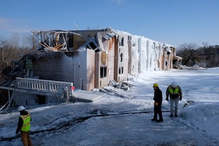 PHOTOS: Lawrence hotel covered in ice after fire