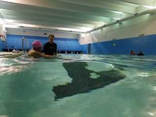 Pastors take swim lessons to inspire youth