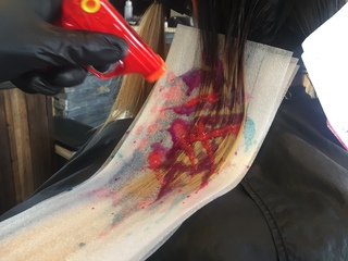 PHOTOS: Hair stylists use water guns to dye hair